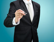 Businessman standing posture hand hold a pen isolated Royalty Free Stock Photography