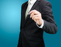 Businessman standing posture hand hold a pen isolated Royalty Free Stock Photo