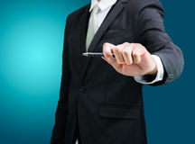 Businessman standing posture hand hold a pen isolated Royalty Free Stock Photos