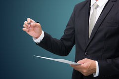 Businessman standing posture hand hold a pen isolated Stock Images