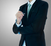 Businessman standing posture hand hold a pen isolated Stock Photo