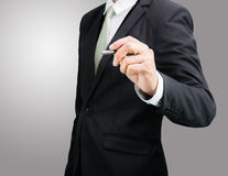 Businessman standing posture hand hold a pen isolated Royalty Free Stock Images