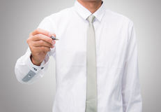 Businessman standing posture hand hold a pen isolated Royalty Free Stock Image