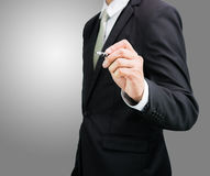 Businessman standing posture hand hold a pen isolated Stock Image