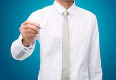 Businessman standing posture hand hold a pen  Stock Image