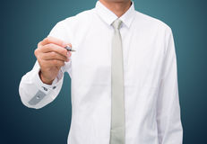 Businessman standing posture hand hold a pen  Royalty Free Stock Photos
