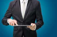 Businessman standing posture hand holding blank tablet  Stock Image