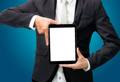 Businessman standing posture hand holding blank tablet  Stock Photography