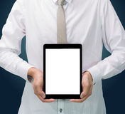 Businessman standing posture hand holding blank tablet. On dark background Royalty Free Stock Images