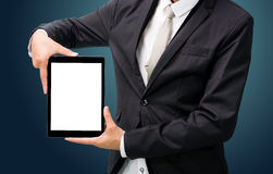 Businessman standing posture hand holding blank tablet  Royalty Free Stock Photography
