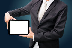 Businessman standing posture hand holding blank tablet  Royalty Free Stock Photos