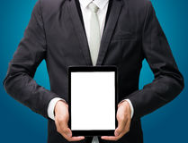 Businessman standing posture hand holding blank tablet isolated Royalty Free Stock Photography