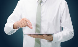 Businessman standing posture hand holding blank tablet isolated Royalty Free Stock Photos