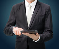 Businessman standing posture hand holding blank tablet isolated Stock Image