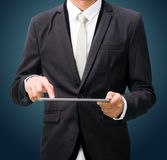 Businessman standing posture hand holding blank tablet isolated Stock Photography