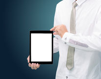 Businessman standing posture hand holding blank tablet isolated. On dark background Royalty Free Stock Image