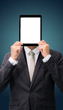 Businessman standing posture hand holding blank tablet isolated. On dark background Stock Images