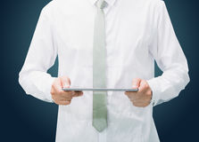 Businessman standing posture hand holding blank tablet isolated Stock Images