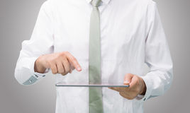 Businessman standing posture hand holding blank tablet isolated Stock Photo