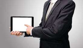 Businessman standing posture hand holding blank tablet isolated Royalty Free Stock Photo