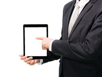 Businessman standing posture hand holding blank tablet. Isolated on over white background Royalty Free Stock Photo
