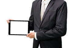 Businessman standing posture hand holding blank tablet. Isolated on over white background Royalty Free Stock Photos