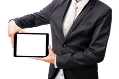 Businessman standing posture hand holding blank tablet Stock Photos