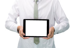 Businessman standing posture hand holding blank tablet. Isolated on over white background Royalty Free Stock Images
