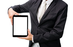 Businessman standing posture hand holding blank tablet. Isolated on over white background Stock Images