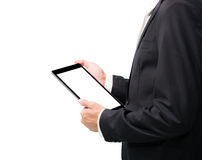 Businessman standing posture hand holding blank tablet Royalty Free Stock Photo