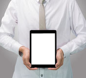Businessman standing posture hand holding blank tablet  Royalty Free Stock Image