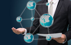 Businessman standing posture hand holding Earth icon  Stock Photo