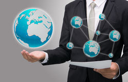 Businessman standing posture hand holding Earth icon  Royalty Free Stock Photo