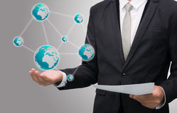 Businessman standing posture hand holding Earth icon isolated. On gray background Royalty Free Stock Photo