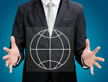 Businessman standing posture hand holding Earth icon isolated. On over blue background Royalty Free Stock Images