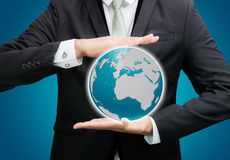 Businessman standing posture hand holding Earth icon isolated Stock Image