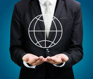 Businessman standing posture hand holding Earth icon isolated Royalty Free Stock Photo