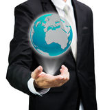 Businessman standing posture hand holding Earth icon isolated Stock Photography