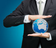 Businessman standing posture hand holding Earth icon  Stock Photos