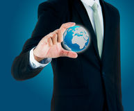 Businessman standing posture hand holding Earth icon  Royalty Free Stock Photos