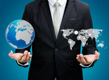 Businessman standing posture hand holding Earth icon  Royalty Free Stock Photography