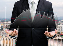 Businessman standing posture hand holding graph finance Stock Photo