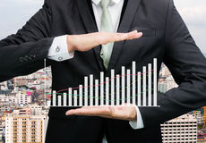 Businessman standing posture hand holding graph finance Royalty Free Stock Images