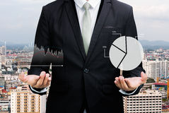 Businessman standing posture hand holding graph finance Royalty Free Stock Photos