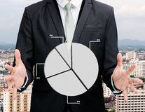 Businessman standing posture hand holding graph finance Stock Images