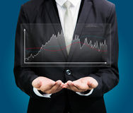 Businessman standing posture hand holding graph finance isolated Stock Photography