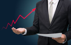 Businessman standing posture hand holding graph finance isolated Royalty Free Stock Image