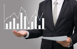 Businessman standing posture hand holding graph finance isolated Royalty Free Stock Photography