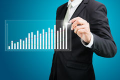 Businessman standing posture hand holding graph finance isolated Stock Image