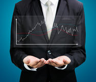 Businessman standing posture hand holding graph finance isolated Stock Images
